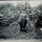 Annie Newbury of Mystic with her bicycle, 1890s