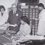 Bill Savitt and women office workers, ca. 1960