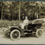 Chauffeur in automobile, 1909