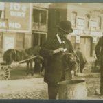 Rabbi about to bleed chicken, Hartford, 1912
