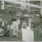 Man operating machine, American Brass Company, 1952