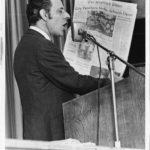 Man holding Hartfor Times newspaper with teachers' strike headline, 1970