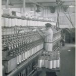 Mill interior, women at roving frame, 1920