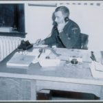 Police officer at desk, Madison, 1946