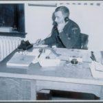 Police officer at desk, Madison, 1946
