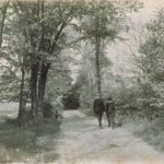 Students walking on Gurleyville road, Storrs, 1930s