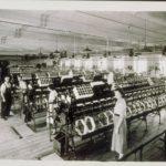 Wauregan and Quinebaug Mills workers with machinery, 1945